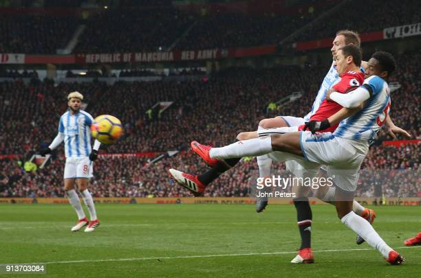 Nemanja Matic of Manchester United in action with Terence Kongolo of Huddersfield Town during the Premier League match between Manchester United and...