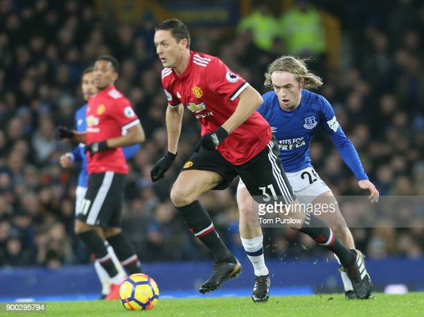 Nemanja Matic of Manchester United in action with Tom Davies of Everton during the Premier League match between Everton and Manchester United at...