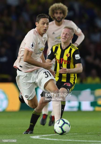 Nemanja Matic of Manchester United in action with Will Hughes of Watford during the Premier League match between Watford FC and Manchester United at...
