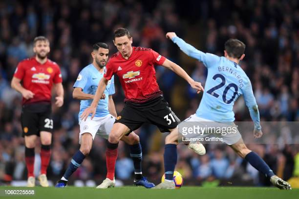 Nemanja Matic of Manchester United is challenged by Bernardo Silva of Manchester City during the Premier League match between Manchester City and...