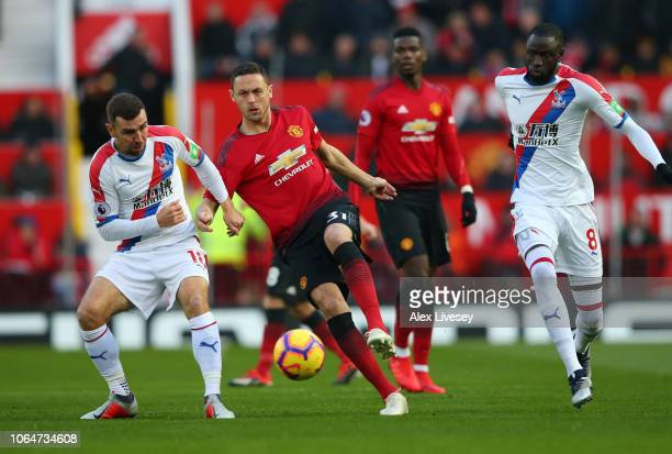 Nemanja Matic of Manchester United is challenged by Cheikhou Kouyate and James McArthur of Crystal Palace during the Premier League match between...