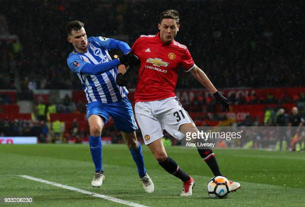 Nemanja Matic of Manchester United is challenged by Pascal Gross during the Emirates FA Cup Quarter Final between Manchester United and Brighton Hove...