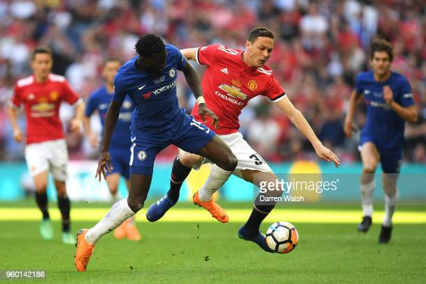 Nemanja Matic of Manchester United is challenged by Tiemoue Bakayoko of Chelsea during The Emirates FA Cup Final between Chelsea and Manchester...