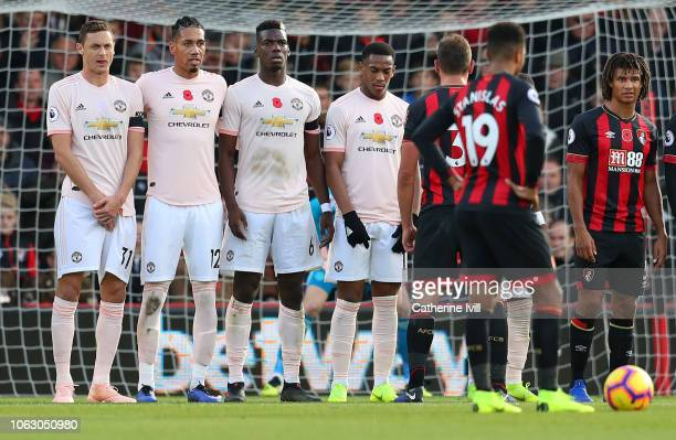 Nemanja Matic of Manchester United lines up with team mates Chris Smalling Paul Pogba and Anthony Martial during the Premier League match between AFC...