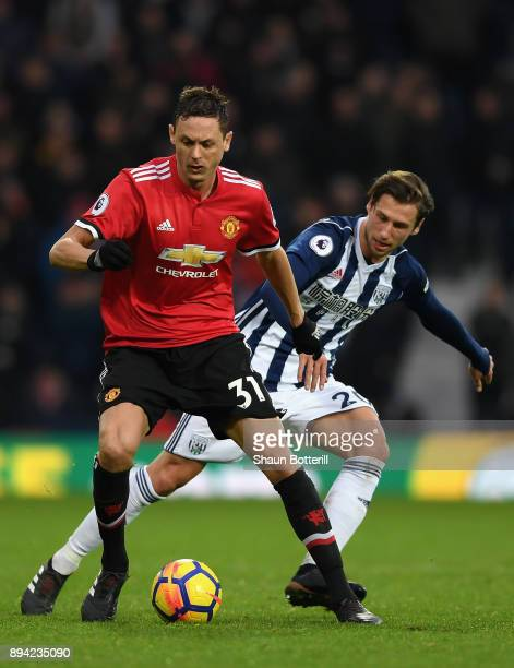 Nemanja Matic of Manchester United on the ball under pressure from Grzegorz Krychowiak of West Bromwich Albion during the Premier League match...