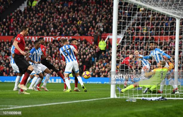 Nemanja Matic of Manchester United scores his team's first goal during the Premier League match between Manchester United and Huddersfield Town at...