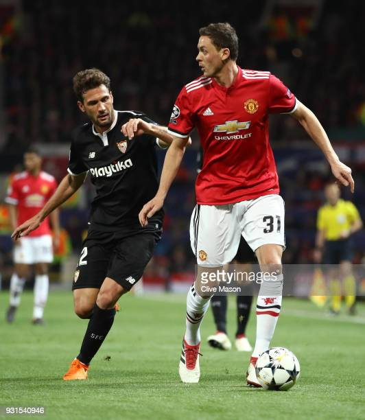 Nemanja Matic of Manchester United shields the ball from Franco Vazquez of Sevilla during the UEFA Champions League Round of 16 Second Leg match...