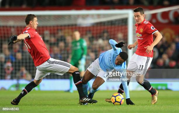 Nemanja Matic of Manchester United tackles Raheem Sterling of Manchester City during the Premier League match between Manchester United and...