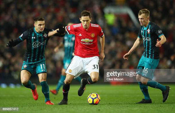Nemanja Matic of Manchester United takes on Dusan Tadic and James WardProwse of Southampton during the Premier League match between Manchester United...
