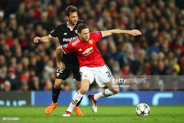 Nemanja Matic of Manchester United tussles with Franco Vazquez of Sevilla during the UEFA Champions League Round of 16 Second Leg match between...