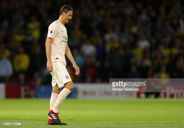 Nemanja Matic of Manchester United walks off the pitch after receiving a red card during the Premier League match between Watford FC and Manchester...
