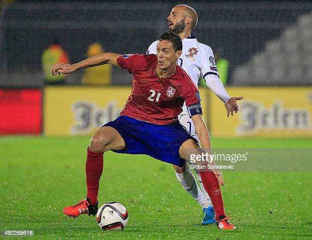 Nemanja Matic of Serbia in action against Andre Andre of Portugal during the Euro 2016 qualifying football match between Serbia and Portugal at the...
