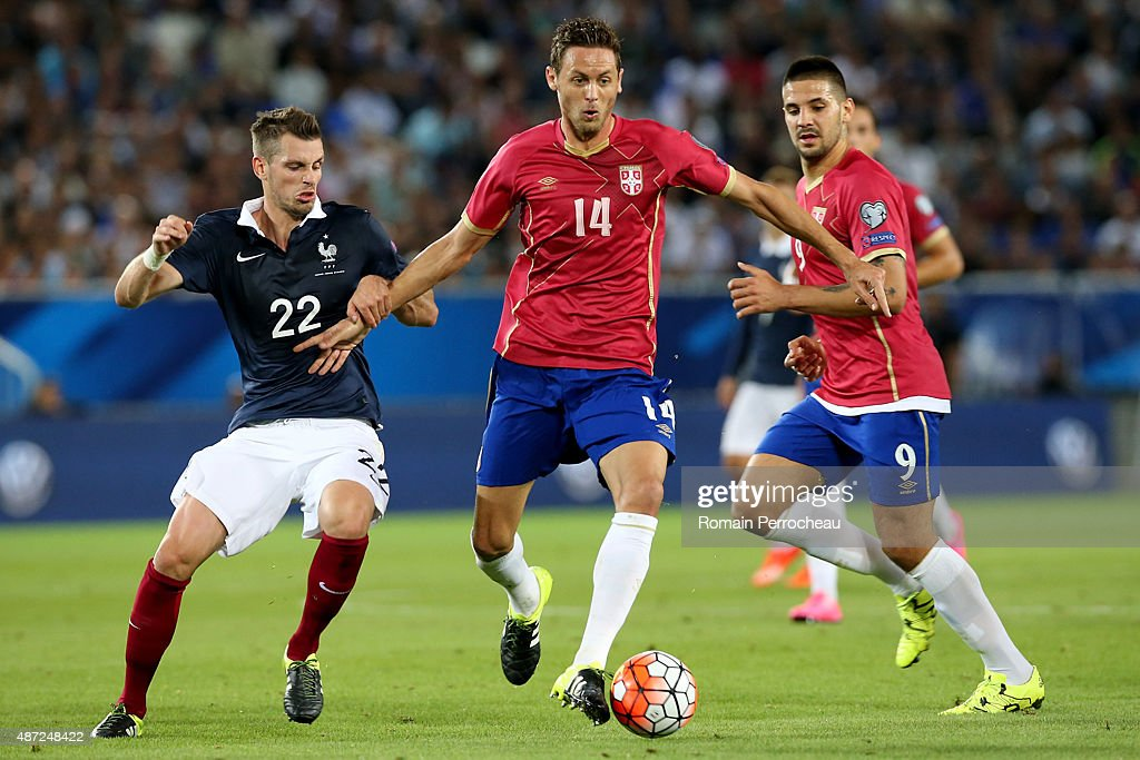 Nemanja Matic of Serbia run with the ball in front Morgan Schneiderlin of France during International Friendly between France and Serbia on September 7, 2015 in Bordeaux, France.
