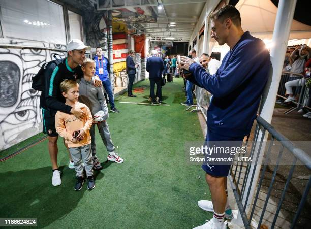 Nemanja Matic of Serbia take a photo of his sons with Cristiano Ronaldo of Portugal during the UEFA Euro 2020 qualifier between Serbia and Portugal...