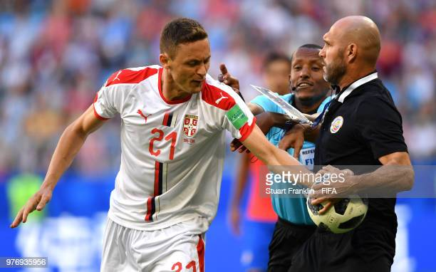 Nemanja Matic of Serbia tries to get the ball from a Costa Rica official as fourth official tries to step in during the 2018 FIFA World Cup Russia...
