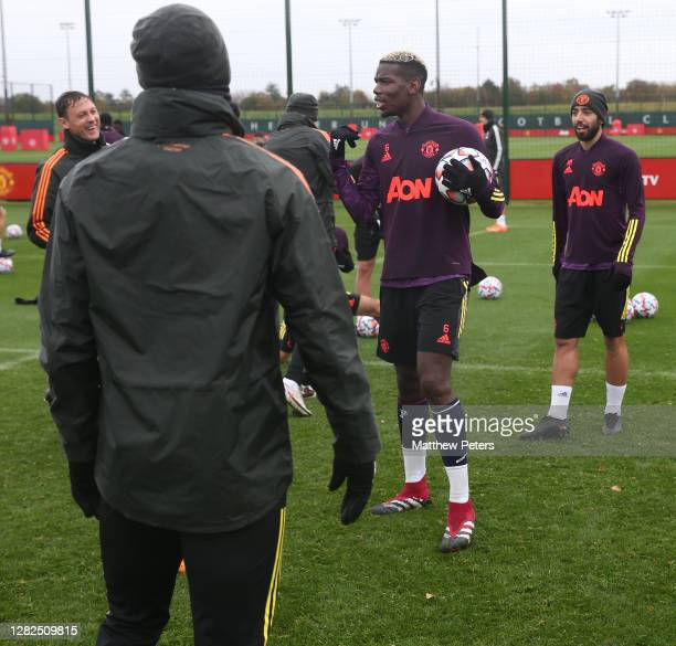 Nemanja Matic Paul Pogba Bruno Fernandes of Manchester United in action during a first team training session ahead of the UEFA Champions League Group...