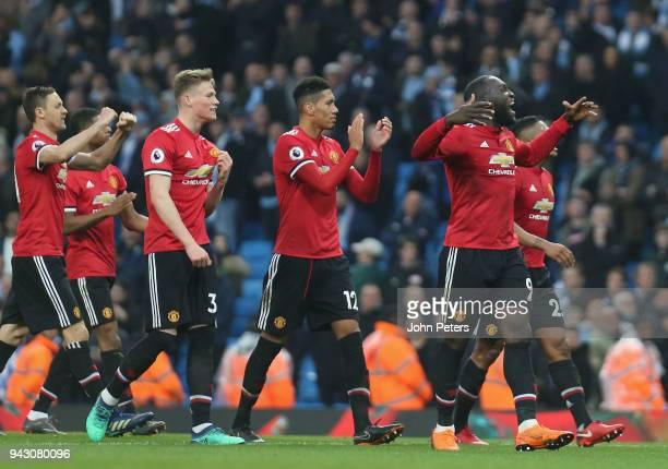 Nemanja Matic Scott McTominay Chris Smalling and Romelu Lukaku of Manchester United celebrate after the Premier League match between Manchester City...