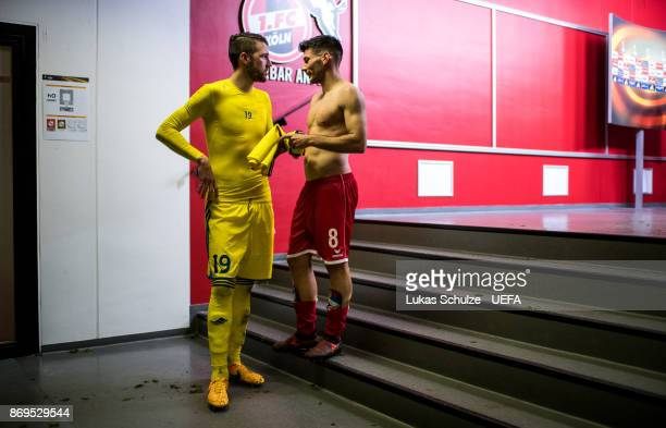 Nemanja Milunovic of Borisov talks to Milos Jojic after the UEFA Europa League group H match between 1 FC Koeln and BATE Borisov at...