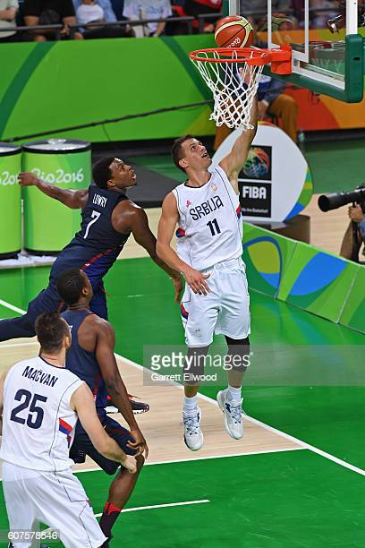 Nemanja Nedovic of Serbia goes to the basket against Kyle Lowry of the USA Basketball Men's National Team during the Gold Medal Game on Day 16 of the...