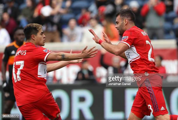 Nemanja Nikolic of the Chicago Fire celebrates his goal with teammate Diego Campos against the Houston Dynamo at Toyota Park on May 20 2018 in...