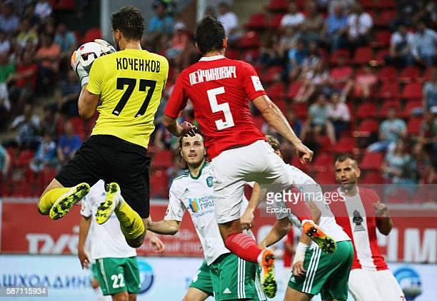 Nemanja Pejchinovich of FC Lokomotiv Moscow challenged by Anton Kochenkov of FC Tom Tomsk during the Russian Premier League match between FC...