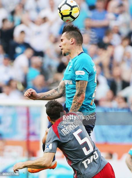 Nemanja Pejchinovich of FC Lokomotiv Moscow vie for the ball with Anton Zabolotny of FC Zenit Saint Petersburg during the Russian Football League...