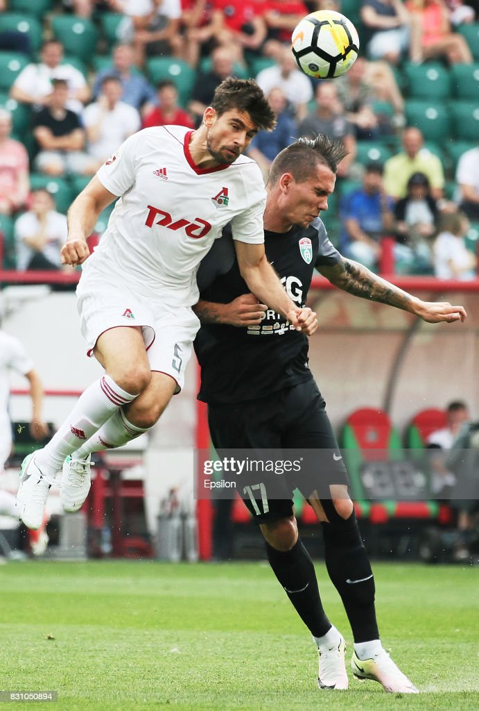 Nemanja Pejchinovich of FC Lokomotiv Moscow vies for the ball with Anton Zabolotny of FC Tosno Khabarovsk during the Russian Premier League match between FC Lokomotiv Moscow and FC Tosno at Lokomotiv stadium on August 13, 2017 in Moscow, Russia.