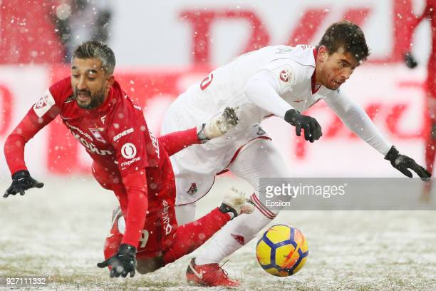 Nemanja Pejchinovich of FC Lokomotiv Moscow vies for the ball with Alexander Samedov of FC Spartak Moscow during the Russian Premier League match...