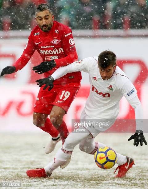 Nemanja Pejchinovich of FC Lokomotiv Moscow vies for the ball with Aleksandr Samedov of FC Spartak Moscow during the Russian Premier League match...