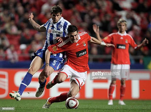 Nemanja Pejcinovic of Berlin battles for the ball with Javi Garcia of Benfica during the UEFA Europa League knockout round second leg match between...