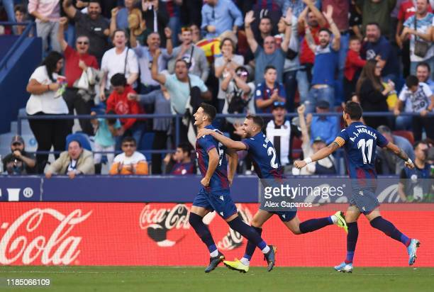 Nemanja Radoja of Levante UD celebrates with teammates after scoring his team's third goal during the Liga match between Levante UD and FC Barcelona...
