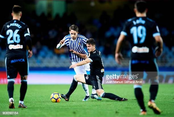 Nemanja Radoja of RC Celta de Vigo duels for the ball with Adnan Januzaj of Real Sociedad during the La Liga match between Real Sociedad de Futbol...