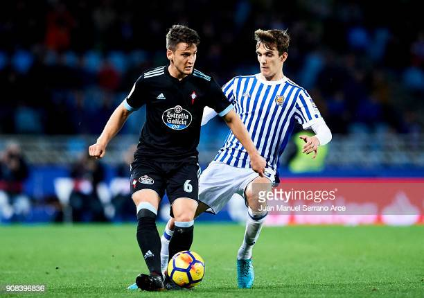 Nemanja Radoja of RC Celta de Vigo duels for the ball with Diego Llorente of Real Sociedad during the La Liga match between Real Sociedad de Futbol...