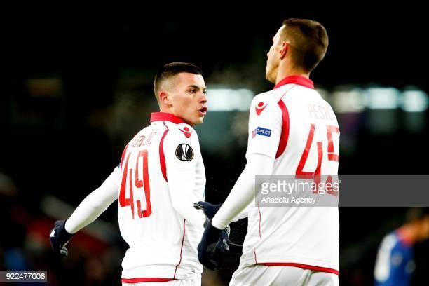 Nemanja Radonjic and Aleksandar Pesic of Crvena Zvezda are seen during the UEFA Europa League round of 32 second leg soccer match between CSKA Moscow...