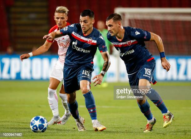 Nemanja Radonjic and Nikola Stojiljkovic of Crvena Zvezda in action during the UEFA Champions League Play Off First Leg match between FK Crvema...