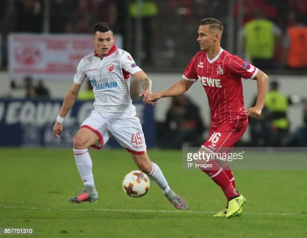 Nemanja Radonjic of Belgrad and Pawel Olkowski of Koeln battle for the ball during the UEFA Europa League group H match between 1 FC Koeln and Crvena...