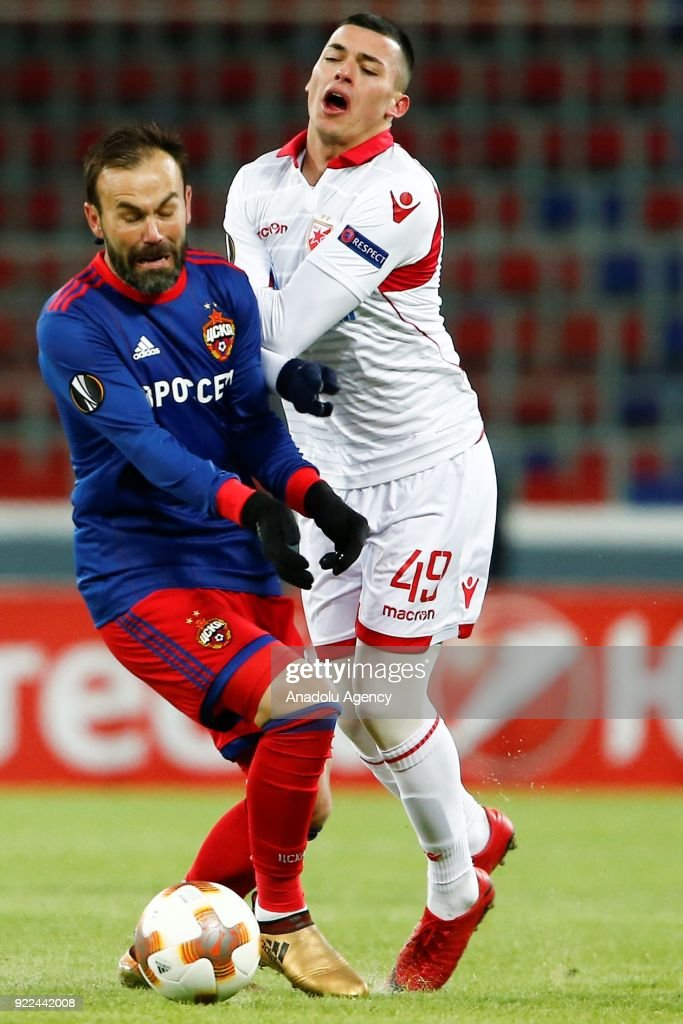 Nemanja Radonjic (R) of Crvena Zvezda in action against Bibras Natcho (L) of CSKA Moscow during the UEFA Europa League round of 32, second leg soccer match between CSKA Moscow and Crvena Zvezda at the Stadium CSKA Moscow in Moscow, Russia on February 21, 2018.