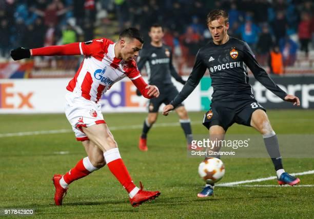 Nemanja Radonjic of Crvena Zvezda in action against Konstantin Kuchaev of CSKA Moscow during UEFA Europa League Round of 32 match between Crvena...