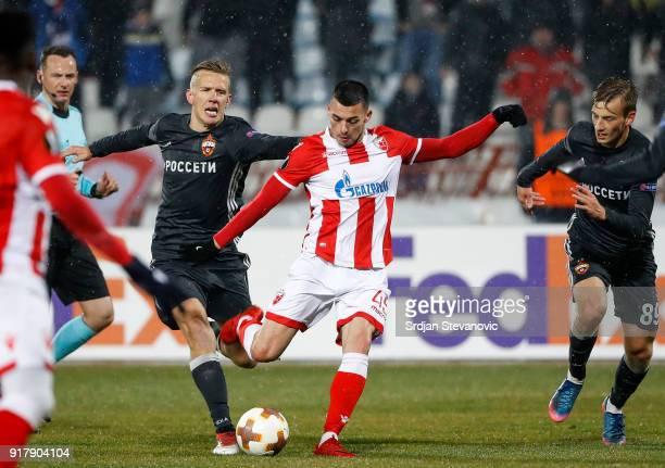 Nemanja Radonjic of Crvena Zvezda in action against Pontus Wernbloom and Konstantin Kuchaev of CSKA Moscow during UEFA Europa League Round of 32...