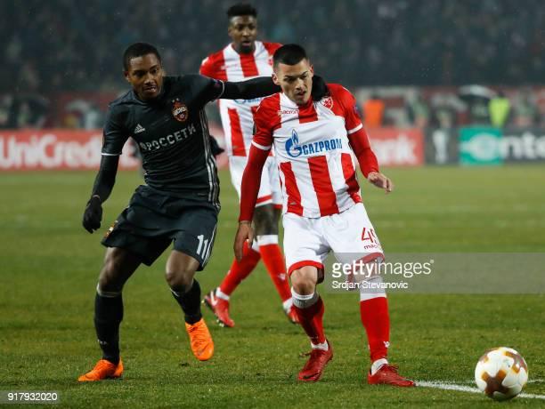 Nemanja Radonjic of Crvena Zvezda in action against Vitinho of CSKA Moscow during the UEFA Europa League Round of 32 match between Crvena Zvezda...