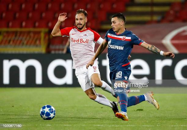 Takumi Minamino of Red Bull Salzburg reacts during the UEFA Champions League Play Off First Leg match between FK Crvema Zvezda and FC Red Bull...