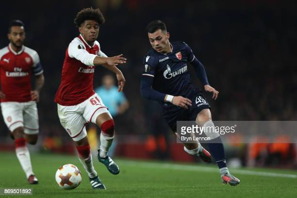 Nemanja Radonjic of FK Crvena Zvezda and Reiss Nelson of Arsenal battle for possession during the UEFA Europa League group H match between Arsenal FC...