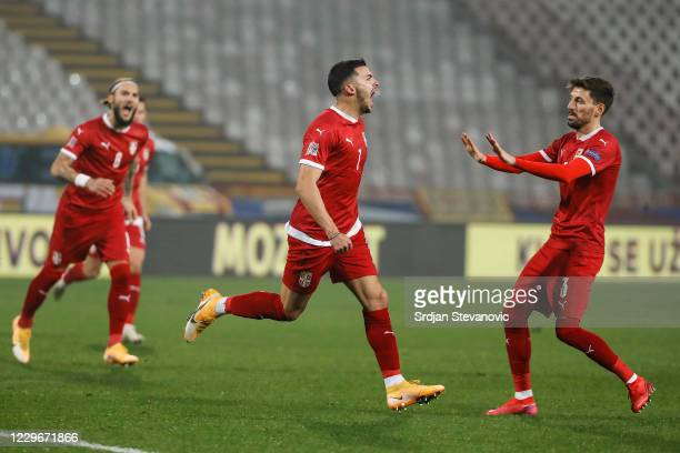 Nemanja Radonjic of Serbia celebrates after scoring a goal with Filip Mladenovic and Nemanja Gudelj during the UEFA Nations League group stage match...
