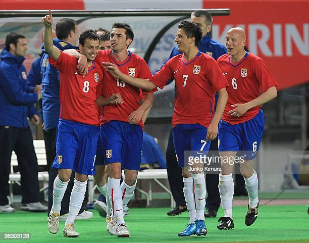 Nemanja Tomic of Serbia celebrates after scoring a goal with his teammates during the Kirin Challenge Cup match between Japan and Serbia at Nagai...