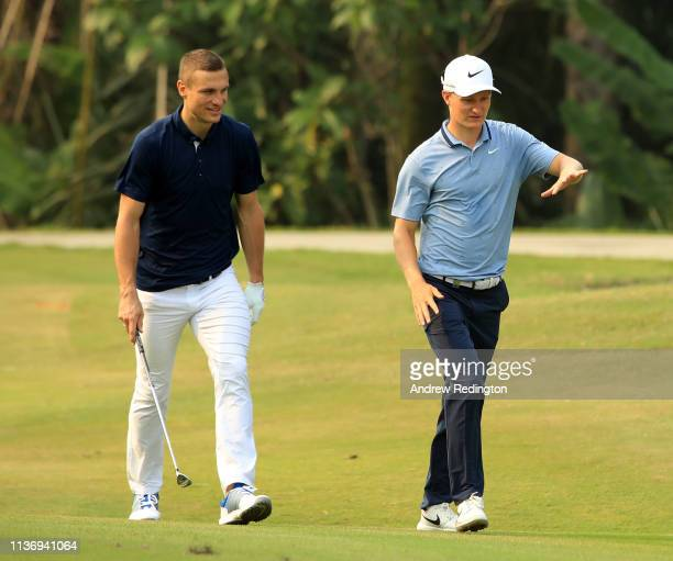 Nemanja Vidić former Manchester United and Serbia footballer and Marcus Kinhult of Sweden chat during the Pro Am event prior to the start of the...