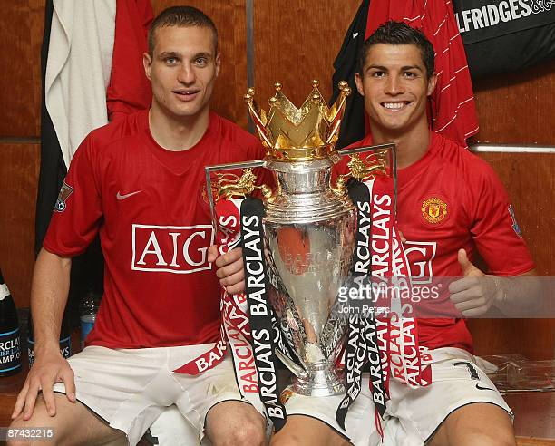 Nemanja Vidic and Cristiano Ronaldo of Manchester United celebrate with the Premier League trophy in the dressing room after the Barclays Premier...