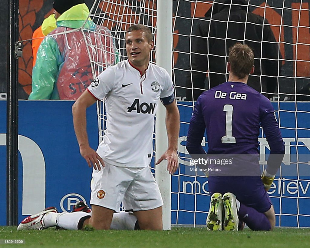 Nemanja Vidic and David de Gea of Manchester United react to conceding a goal during the UEFA Champions League Group A match between Shakhtar Donetsk and Manchester United at Donbass Arena on October 2, 2013 in Donetsk, Ukraine.