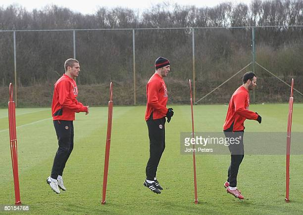 Nemanja Vidic, John O'Shea and Ryan Giggs of Manchester United in action during a First Team Training Session at Carrington Training Ground on March...