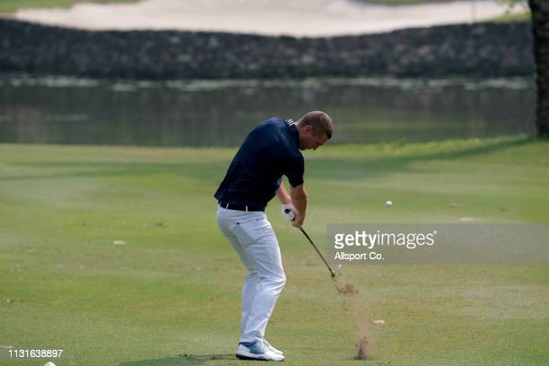 Nemanja Vidic legend player of Manchester United plays a shot on the 12th hole during ProAm day of the Maybank Championship at Saujana Golf and...