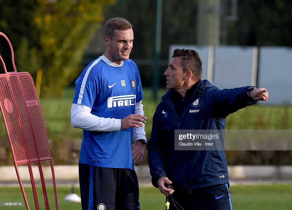 Nemanja Vidic (L) looks on during a FC Internazionale training session at the club's training ground at Appiano Gentile on October 29, 2015 in Como, Italy.
